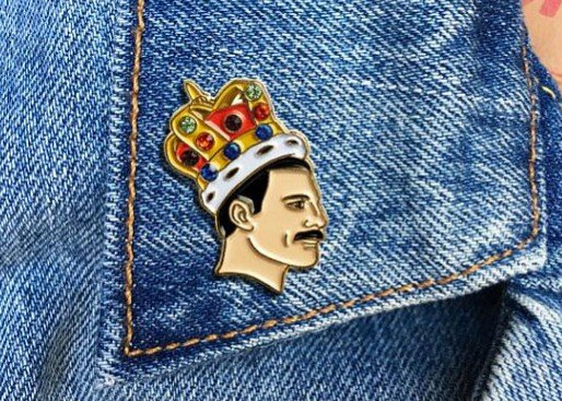86bac5bbb8cc64 Show your love for Freddie every day with this crown pin. This pin is  outlined in gold metal and affixed with four colored gemstones – just the  way Freddie ...